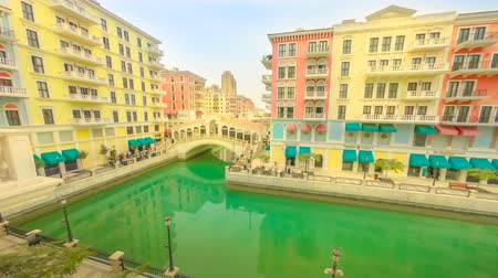Doha, Qatar - February 20, 2019:TIME LAPSE Aerial view of Venetian Rialto bridge of luxurious district of Doha. Venice at Qanat Quartier in the Pearl-Qatar, Persian Gulf Middle East