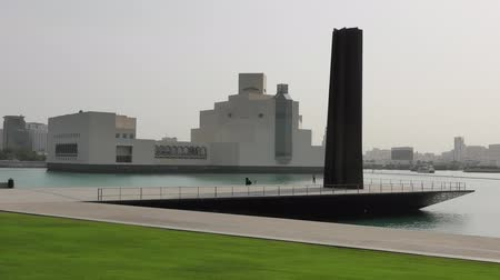 mia : Doha, Qatar - February 16, 2019: modern sculpture Steel Obelisk of Museum of Islamic Art, icon of Doha, one of most complete collections of Islamic artifacts, Mia Park near Corniche Doha Bay, Qatar.