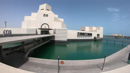 mia : Doha, Qatar - February 16, 2019: modern architecture of Museum of Islamic Art, icon of Doha, one of most complete collections of Islamic artifacts, Mia Park near Corniche Doha Bay, Qatar, Middle East