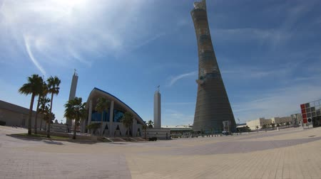 aspire : Doha, Qatar - February 21, 2019: Aspire Masjid Mosque with Aspire Tower at Aspire Zone in Doha Sports City. Sunny day with blue sky.