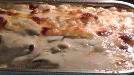 bolonhesa : Baked lasagna with tomato sauce, cheese and bechamel. Close up view of boiling sauce in baking tin.