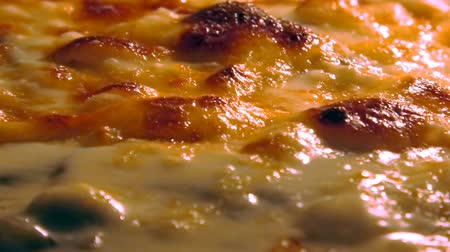salame : Pizza with tomato and cheese cooking in the oven. Close up view of boiling cheese.