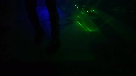 fluo : woman dancer in black and fluorescent dress, dancing in the dark with green laser lights. Entertainment, leisure and nightlife concept. Adult lifestyle. Stockvideo