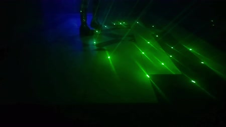 serseri : disco background with a woman dancer in black dress, dancing in the dark with green laser lights. Entertainment, leisure and nightlife concept. Adult lifestyle. Stok Video