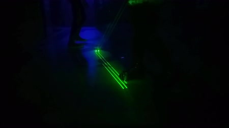 pankáč : People dancing under green strobe lights in a dark disco club. Entertainment in discotheque. leisure and nightlife concept. Dostupné videozáznamy