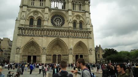 デイム : Paris, France - July 1, 2017: Notre Dame de Paris square, popular landmark and cathedral of the capital of France. Gothic French architecture of Our Lady of Paris in a sunny day, blue sky.