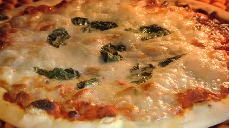 mozzarelle : circular pizza with tomato, mozzarella cheese and basil leaves, baking in the oven with boiling mozzarella. Italian recipe.
