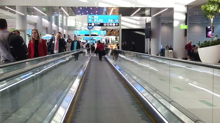 kalkış : Istanbul, Turkey - May 7, 2019: SLOW MOTION people moving on travelators for quicker transfer in Istanbul International Airport, Istanbul Yeni Havalimani. Main hub of Turkish Airlines in Europe.