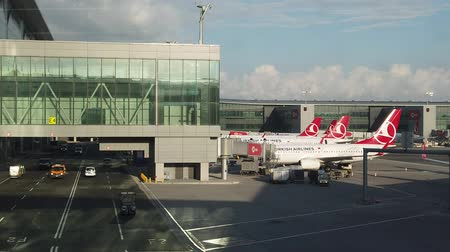 inchecken : Istanbul, Turkey - May 7, 2019: SLOW MOTION airplanes on runway for refueling and loading of Turkish Airlines in new Istanbul International Airport, Istanbul Yeni Havalimani. hub of Turkish Airlines. Stockvideo