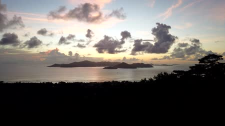 praslin : TIME LAPSE: spectacular seascape of Seychelles and Indian Ocean at sunset. Panorama of the Praslin Island from top view of La Digue.