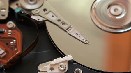 hdd : close up of interior of an hard disk drive writing data on the support with its head.