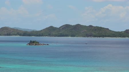 anse : Panorama of Cote dOr Bay of Praslin island of Seychelles. Overlook with Curieuse, St. Pierre and Chauvre Souris Island. close up view Stock Footage