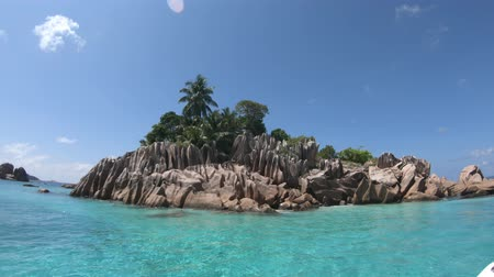 marine park : Split view underwater of St. Pierre Island coral reef in Seychelles. sealife of Indian Ocean, under and above water. Stock Footage