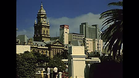 cola : CAPE TOWN, South Africa - CIRCA 1980: Castle of Good Hope with cannons. Clock Tower of City Hall of 1905 in Grand Parade square. Historical archival footage in Cape Town city of South Africa in 1980s.