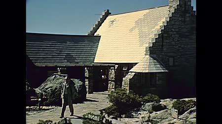 fülke : CAPE TOWN, South Africa - CIRCA 1980: tourists visiting Table Mountain nature reserve, top of the mountain with buildings. Historical archival footage in Cape Town city of South Africa in 1980s. Stock mozgókép