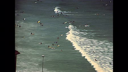 lookout point : Aerial view of Noordhoek Beach. Surfing in Cape Town. Surfers riding big waves of Atlantic coast in Table Mountain National Park. Archival of Cape Town city of South Africa in 1980s Stock Footage