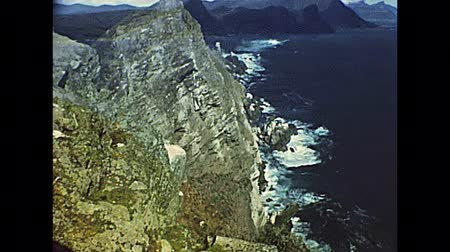 lookout point : Aerial view of Cape of Good Hope in South Africa, looking towards the west, from the coastal cliffs above Cape Point, overlooking Dias beach. Archival of Cape Town city of South Africa in 1980s Stock Footage