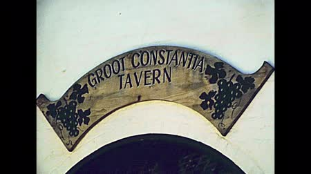taberna : CAPE TOWN, South Africa - CIRCA 1980: Groot Constantia tavern wine tasting and cellar tours. Historical wine museum and winery. archival footage in Cape Town city of South Africa in 1980s.