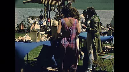 ochenta : CAPE TOWN, South Africa - CIRCA 1980: Historical re-enactment and countryside market in Cape Town city of South Africa in 1980s. People in vintage dress. ARCHIVAL FOOTAGE