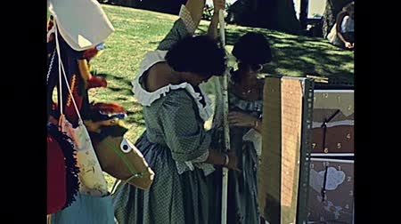 архив : CAPE TOWN, South Africa - CIRCA 1980: People in vintage dress in historical re-enactment and countryside market in Cape Town city of South Africa in 1980s. ARCHIVAL FOOTAGE Стоковые видеозаписи