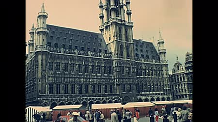 BRUSSELS, BELGIUM - CIRCA 1975: Maison de lArbre dOr and Brussels City Hall in Grand Place square. Historical palace: Hotel de Ville de Bruxelles. Archival in the capital city of Belgium in 1970s.