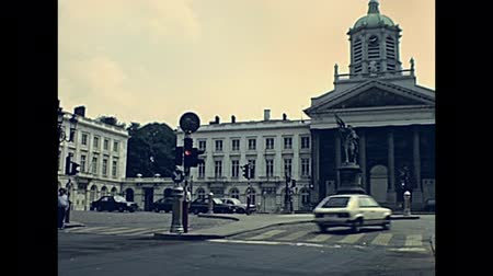BRUSSELS, BELGIUM - CIRCA 1975: Saint-Jacques on the Coudenberg Catholic church. Statue of Godfrey of Bouillon in Place Royale square. Historical archival in Bruxelles capital city of Belgium in 1970s