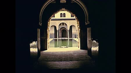 GRANADA, SPAIN - CIRCA 1974: The Patio de los Arrayanes or courtyard of the Myrtles within the popular Palacios Nazaries. Historical archival of Granada city of Spain in 1970s.