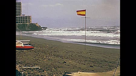 andalucia : ANDALUSIA, SPAIN - CIRCA 1974: Tourists on a beach of Costa del Sol for vacation. Historical archival of Andalusia region of Spain in 1970s.