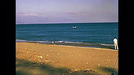 andalucia : Tourists in the Mediterranean sea of a typical beach of Costa del Sol on holiday. Historical archival of Andalusia region of Spain in 1970s. Stock Footage