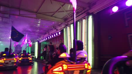 bologna : Province of Bologna, Italy - June 8, 2019: Ride on amusement park bumper cars with European contries flags, driving point of view POV and hitting each other. Stock Footage