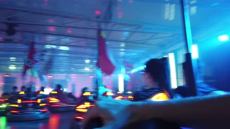 bolognai : Province of Bologna, Italy - June 8, 2019: POV driving dodgem car in Amusement Park track with laser lights and crashing each other. Cars with European contries flags.
