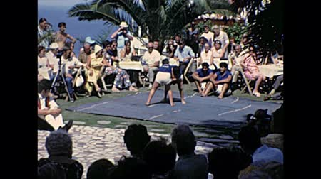 kanarya adaları : TENERIFE, SPAIN - CIRCA 1976: wrestlers fighting in a Canary islands traditional festival with Greco-Roman wrestling. Historical archival of Tenerife island of Spain in Africa in 1970s.