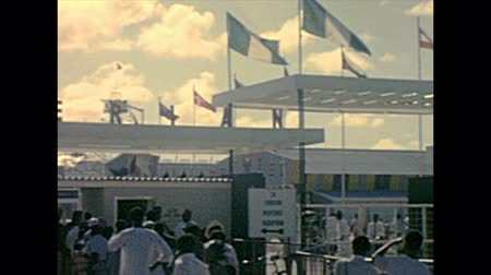 lagos : LAGOS, NIGERIA, AFRICA - circa November 1977: entrance gate of Lagos Nigerian International Trade Fair LITF with black people visitors. Historical archival of Nigeria state of Africa in 1970s.