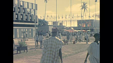 lagos : LAGOS, NIGERIA, AFRICA - circa November 1977: panorama of Nigerian International Trade Fair LITF with black people visitors trading. Historical archival of Nigeria state of Africa in 1970s. Stock Footage