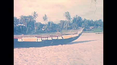gine : Traditional Nigerian boats on the beach of guinea gulf in Lagos. Historical archival of Lagos city of Nigeria state of Africa in 1970s.