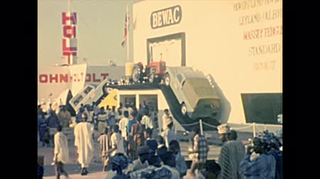 lagos : LAGOS, NIGERIA, AFRICA - circa November 1977: industrial pavilions in Nigerian International Trade Fair of Lagos with black men visitors. Historical archival of Nigeria state of Africa in 1970s.