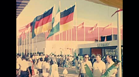 nigeria flag : LAGOS, NIGERIA, AFRICA - circa November 1977: pavilion of Germany with flags at Nigerian International Trade Fair LITF. Historical archival of Nigeria state of Africa in 1970s.