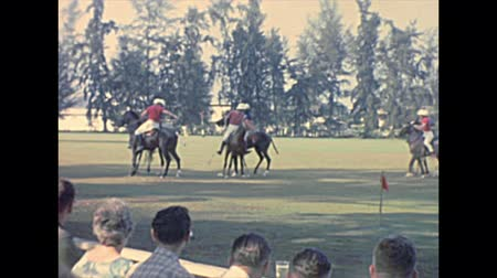 lagos : LAGOS, NIGERIA, AFRICA - circa 1977: polo game riding horses in Lagos city at Lagos Polo Club with white people playing. Archival of Nigeria lagos island of Africa in 1970s.