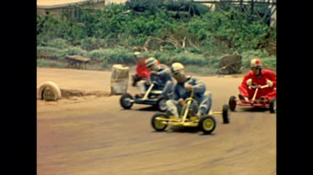 seventy : LAGOS, NIGERIA, AFRICA - circa 1977: go-kart racing in Lagos city arena. Archival of Nigeria of Africa in 1970s. Stock Footage