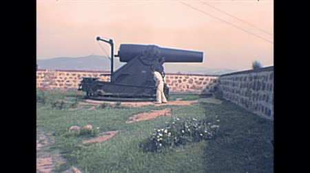 kuşatma : BARCELONA, SPAIN - CIRCA 1970: cannons of the Montjuic Castle, ancient military fortress of Catalonia region overlooking Barcelona  city. Historical archival of Catalonia city of Spain in 1970s.