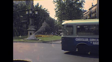super car : BARCELONA, SPAIN - CIRCA 1970: The vintage bus crossing Barcelona  city downtown. Historical archival of Catalonia of Spain in 1970s.