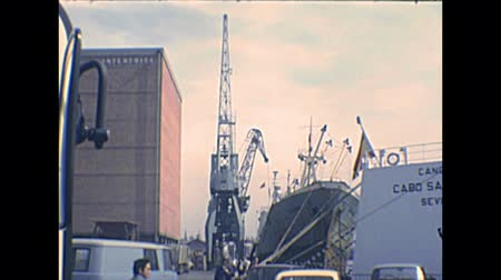 super car : BARCELONA, SPAIN - CIRCA 1970: Barcelona  port with big ferry boats and cargo ships loading containers. Historical archival of Catalonia of Spain in 1970s. Stock Footage