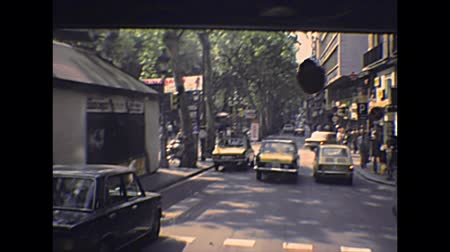 super car : BARCELONA, SPAIN - CIRCA 1970: vintage cars driving by on Barcelona city streets with people in vintage dress. Historical archival of Catalonia of Spain in 1970s.