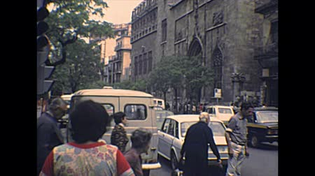 silk road : VALENCIA, SPAIN - CIRCA 1970: Placa del Mercat road with famous buildings, Central market and Lonja de la Seda. Valencian Gothic-style UNESCO building. Archival of Valencia city of Spain in 1970s