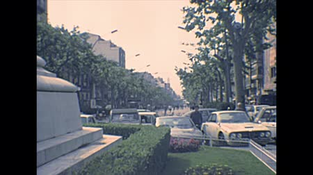 super car : TARRAGONA, SPAIN - CIRCA 1970: main street Rambla Nova of Tarragona city. leading to Balcon del Mediterraneo overlook. People walking in vintage dress and vintage cars. Archival of Catalonia.