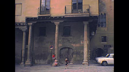 archief : TARRAGONA, SPAIN - CIRCA 1970: children playing in plaza de la Seu square of Tarragona Cathedral. Archival of Catalonia region of Spain in 1970s. Stockvideo