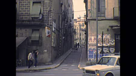 super car : TARRAGONA, SPAIN - CIRCA 1970: old streets of Tarragona city. People in vintage dress and vintage cars on the road. Archival of Catalonia region of Spain in 1970s.
