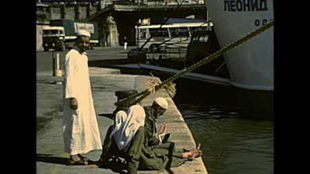 ochenta : Port Said, Egypt, AFRICA - circa 1982: Egyptian fishermen in the harbor of Port Said on Mediterranean sea. Historical archival of Egypt state of Africa in 1980s. Archivo de Video