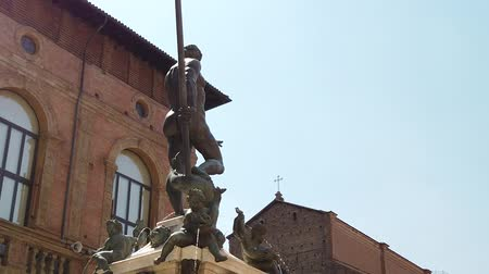 bolognai : SLOW MOTION: Neptune statue and restored fountain. Perspective view from the shame-stone, where a penis silhouette can be seen on the statue of Neptune.