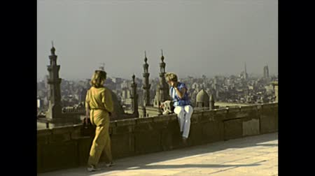 muhammad ali : CAIRO, EGYPT, AFRICA - circa 1982: aerial view from the rooftop of the Mosque of Muhammad Ali with tourists. Historical archival of Cairo capital city of Egypt in 1980s Stock Footage
